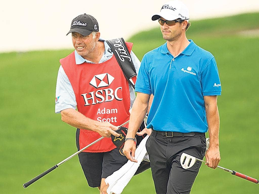 Steve Williams (left) caddying for Adam Scott in Shanghai this week