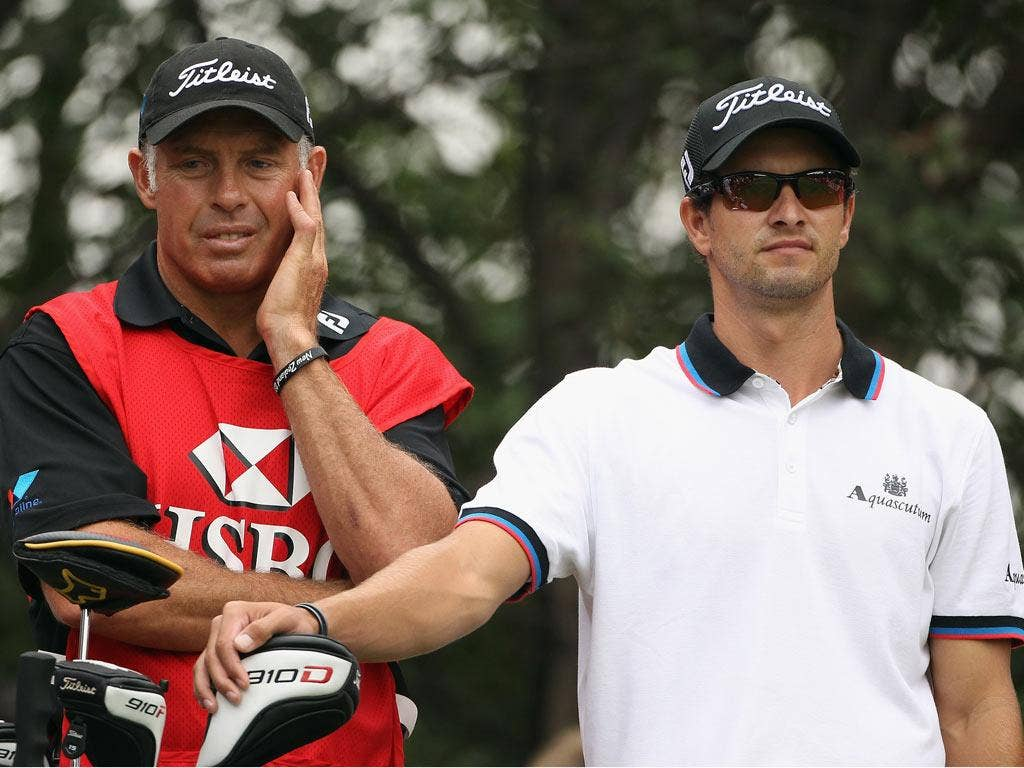 Caddie Steve Williams appears to have plenty on his mind during Adam Scott's final round in Shanghai