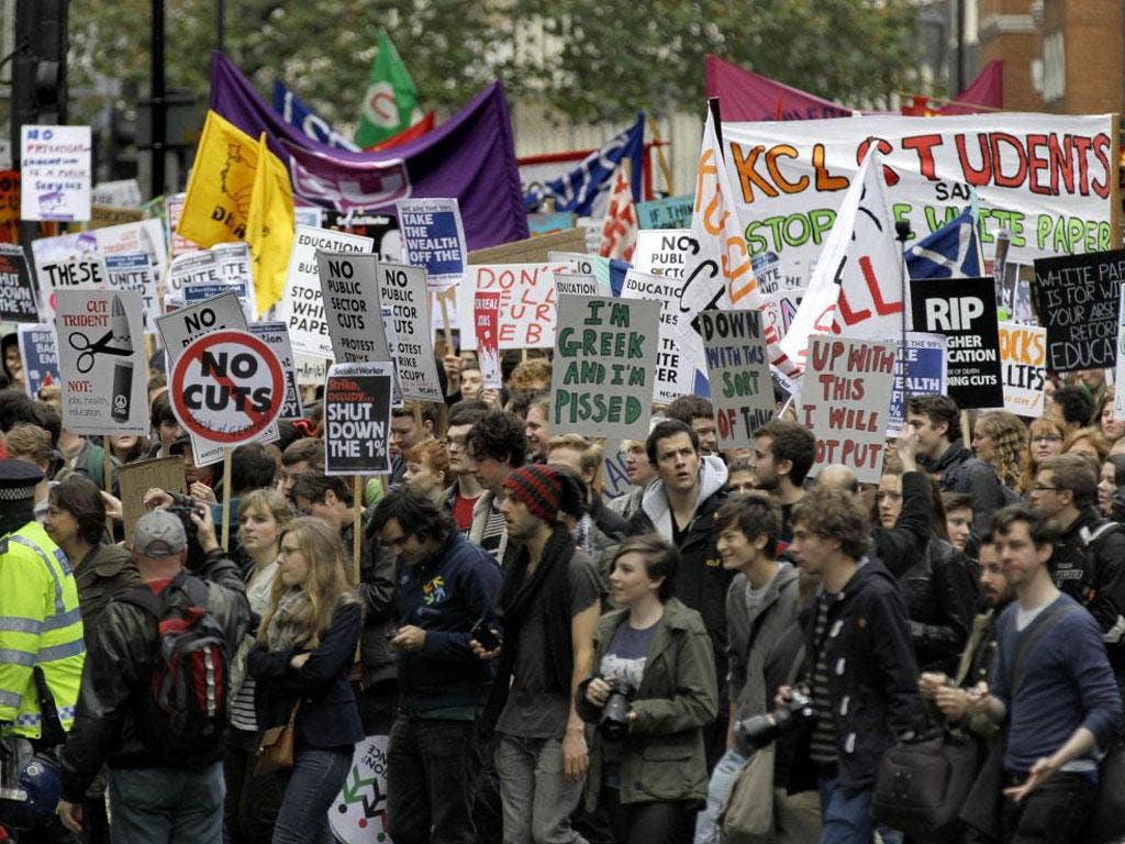 Students and campaigners march through the streets of London to protest against higher tuition fees