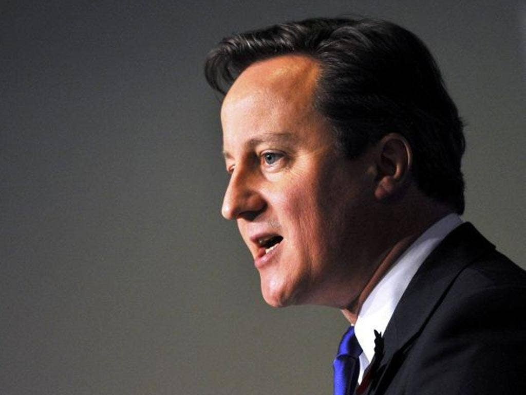 A warning of difficult times ahead for the British economy was issued by David Cameron today