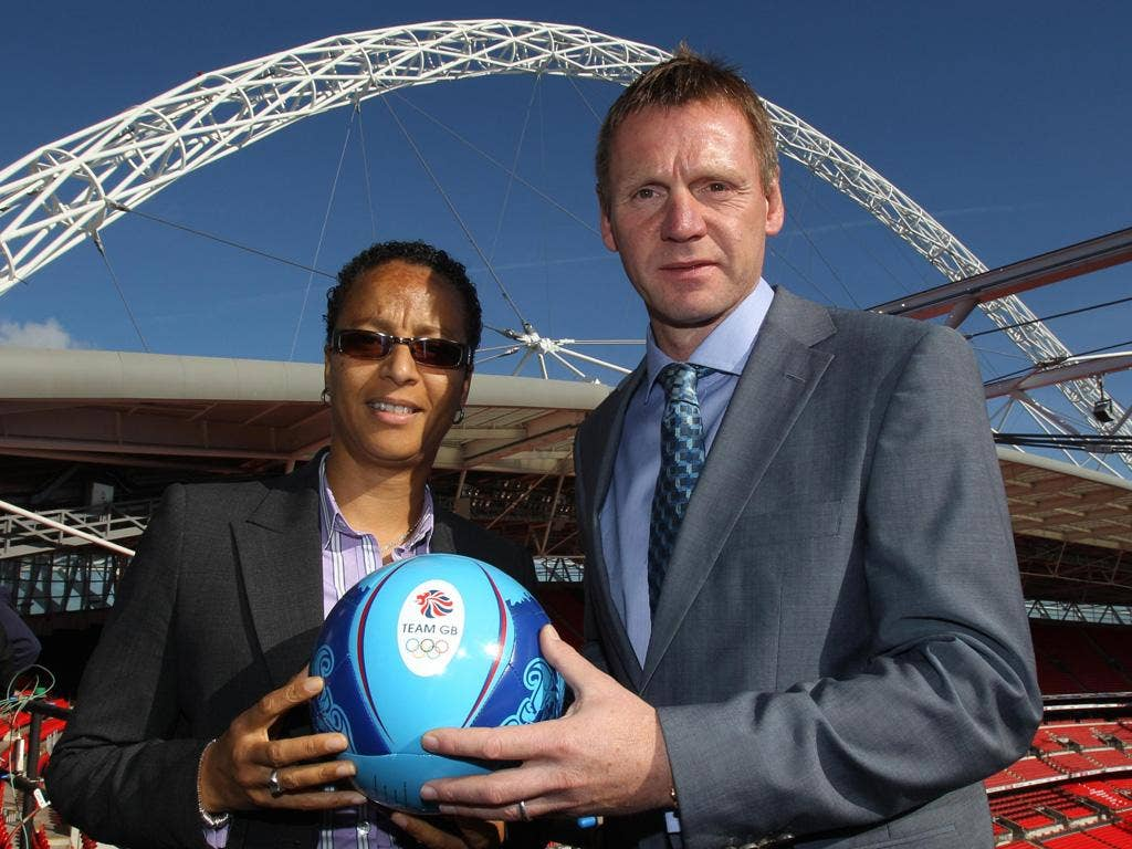Hope Powell (left) and Stuart Pearce will lead the men's and women's sides at the London Games