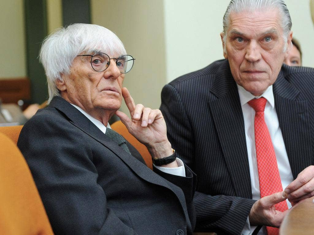 Bernie Ecclestone with his lawyer, Sven Thomas, in court yesterday