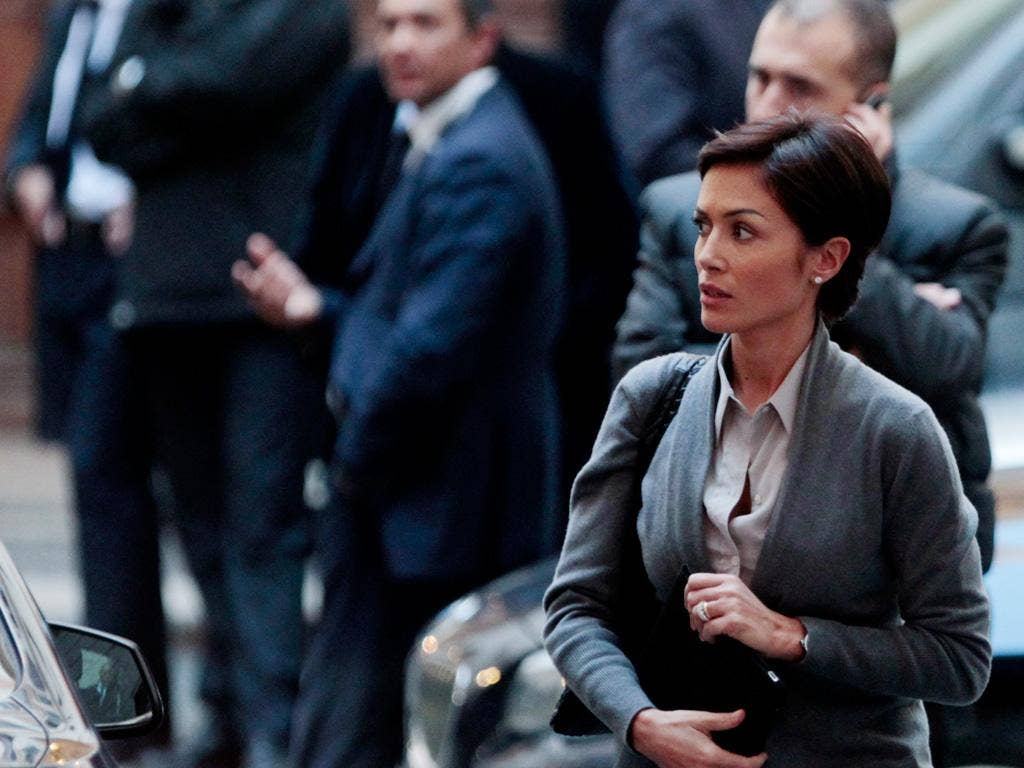 Silvio Berlusconi's Equal Opportunities Minister Mara Carfagna arrives at his Rome residence yesterday on another day of political confusion in Italy