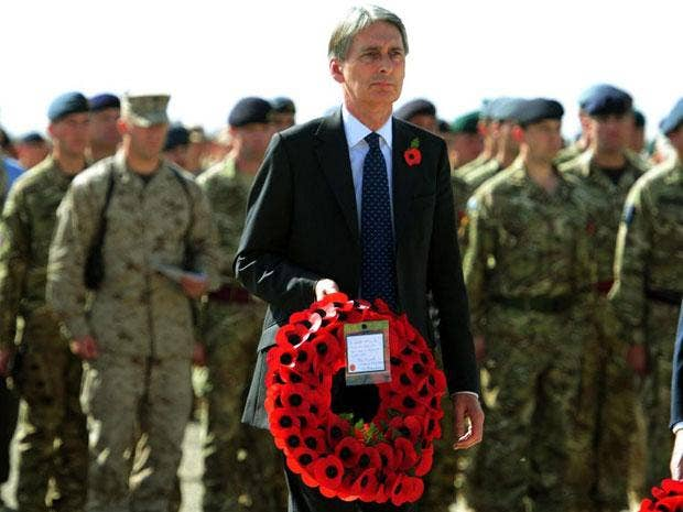 Philip Hammond marked Armistice Day alongside troops in Afghanistan at a special parade in Camp Bastion today