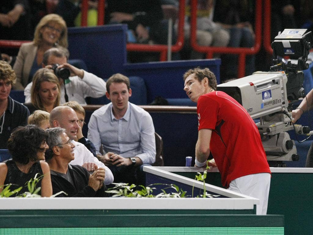 Andy Murray feels the strain during a tight three-set defeat yesterday