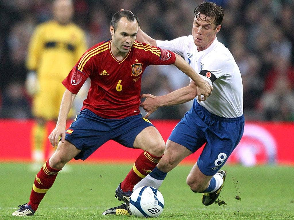 England's Scott Parker spent the evening stopping Andres Iniesta pick out passes to his Spain team-mate David Silva at Wembley on Saturday