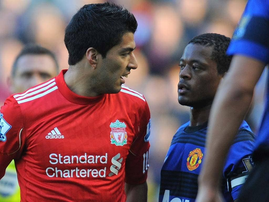 Suarez confronts Evra in the match between Liverpool and Manchester United