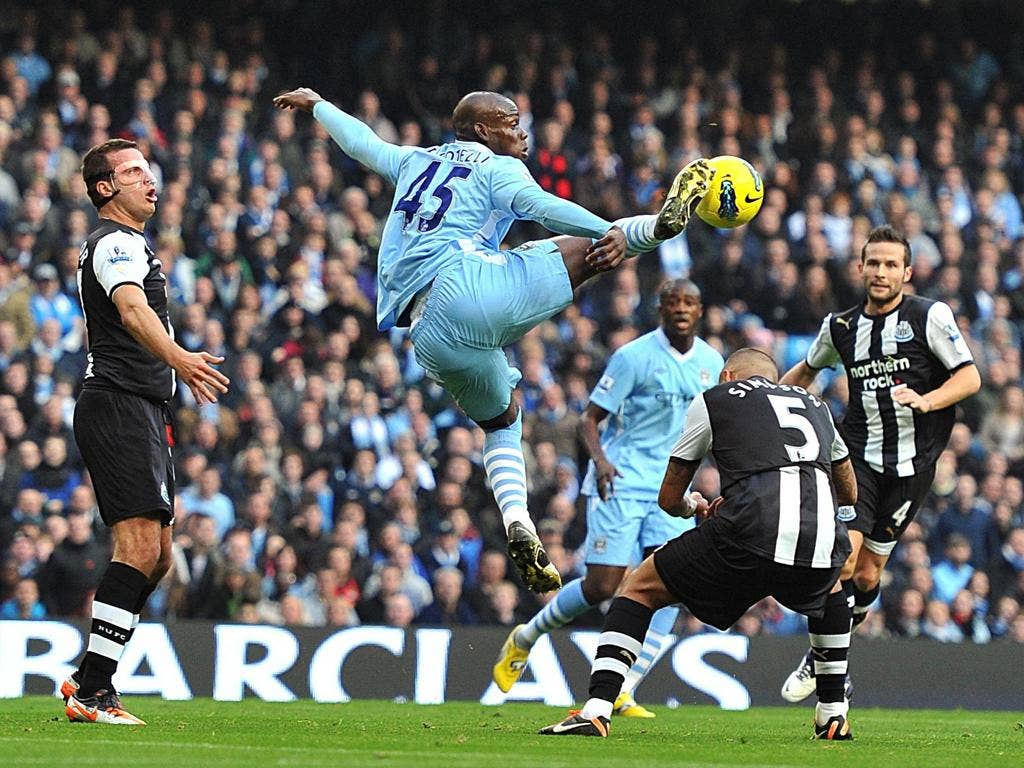 Manchester City striker Mario Balotelli leaps high to control theball brilliantly against Newcastle at the Etihad Stadium yesterday