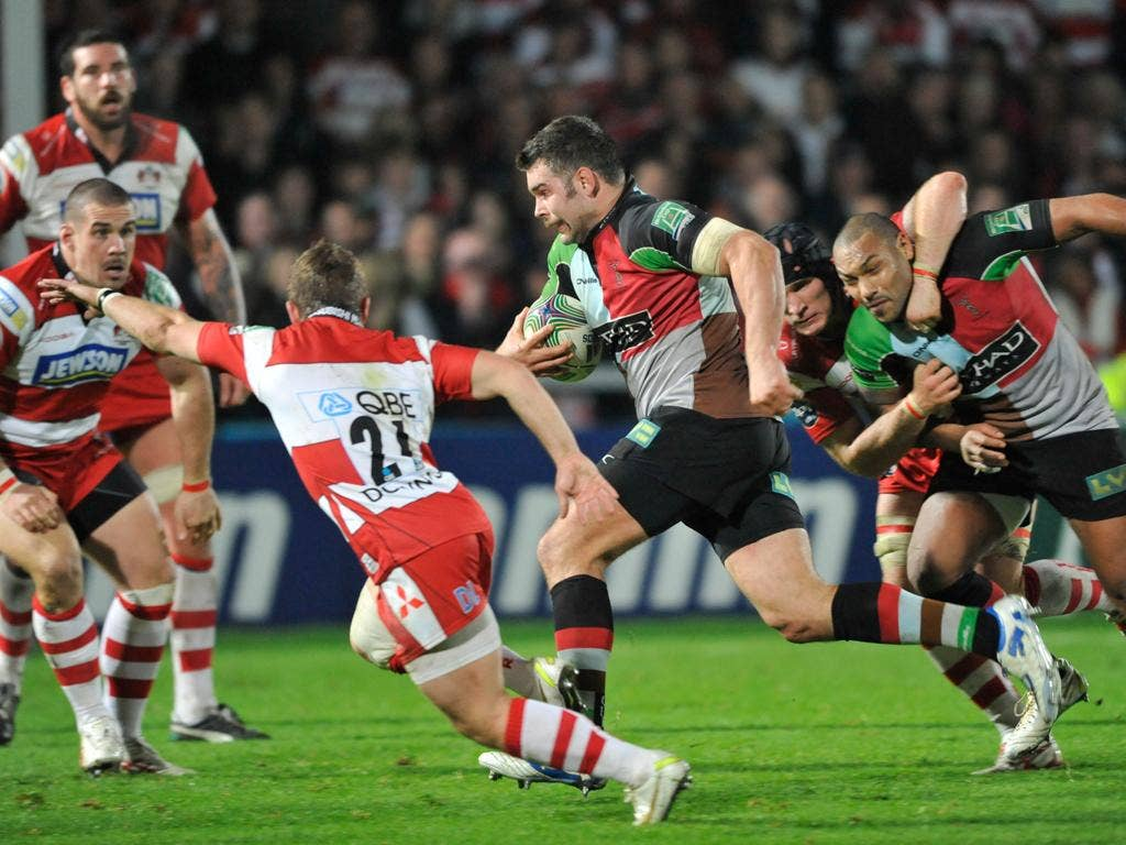Harlequins No 8 Nick Easter runs in his side's third try against Gloucester at Kingsholm