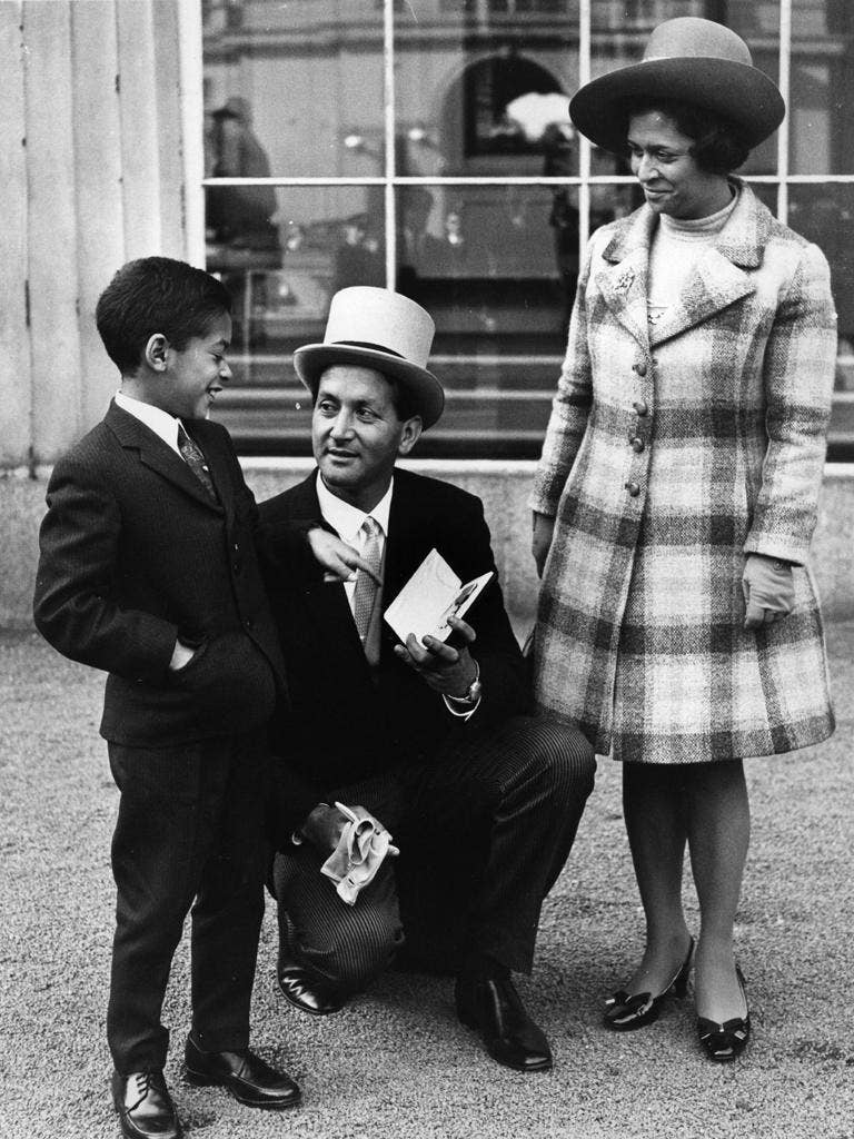 D'Oliveira with family and OBE in 1969