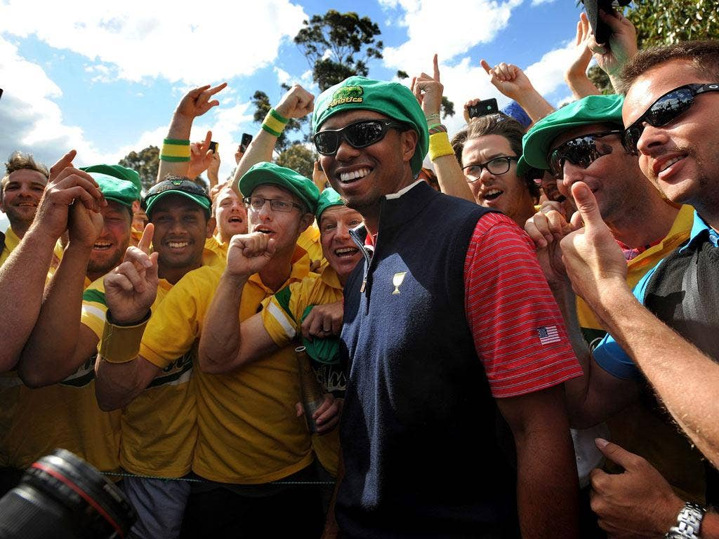 Tiger Woods celebrates with fans after winning for the US in Melbourne