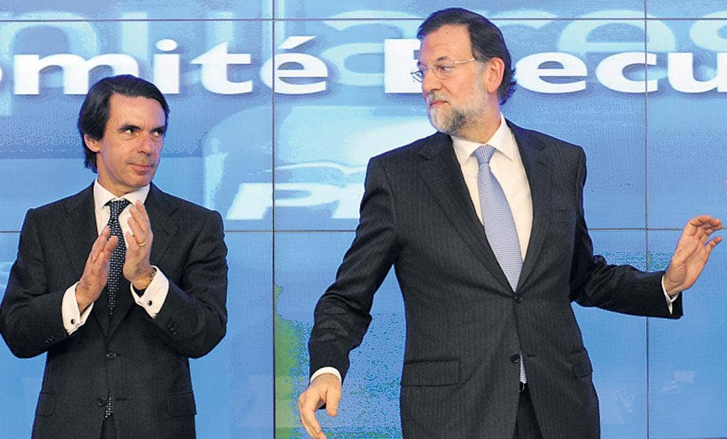 Mariano Rajoy, right, with former premier Jose Maria Aznar yesterday, said the economy was in 'its most delicate situation for 30 years'