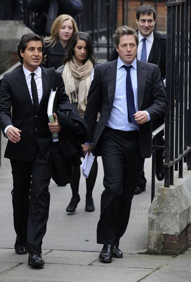 Hugh Grant arrives at the Leveson Inquiry at the High Court in London