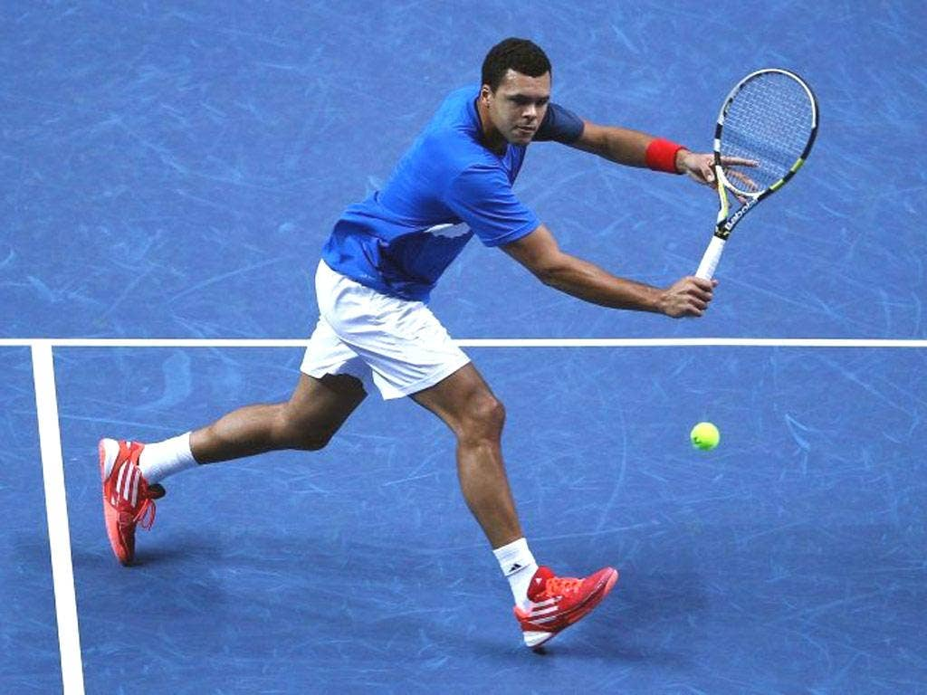Jo-Wilfried Tsonga returns the ball against Mardy Fish