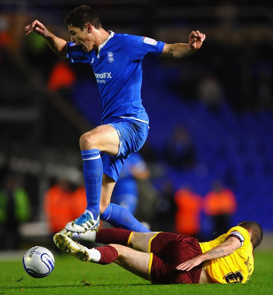 Birmingham's Nikola Zigic gets the better of Chris McCann last night