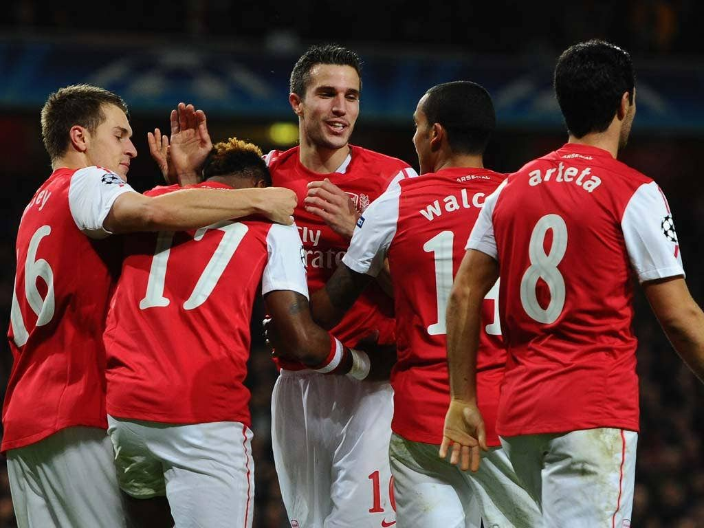 Arsenal qualified for the Champions League knock-out stage last night