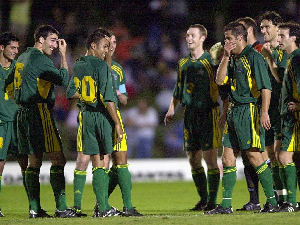 American Samoa were famously beaten 31-0 by Australia (pictured sharing a joke during that match) back in 2001