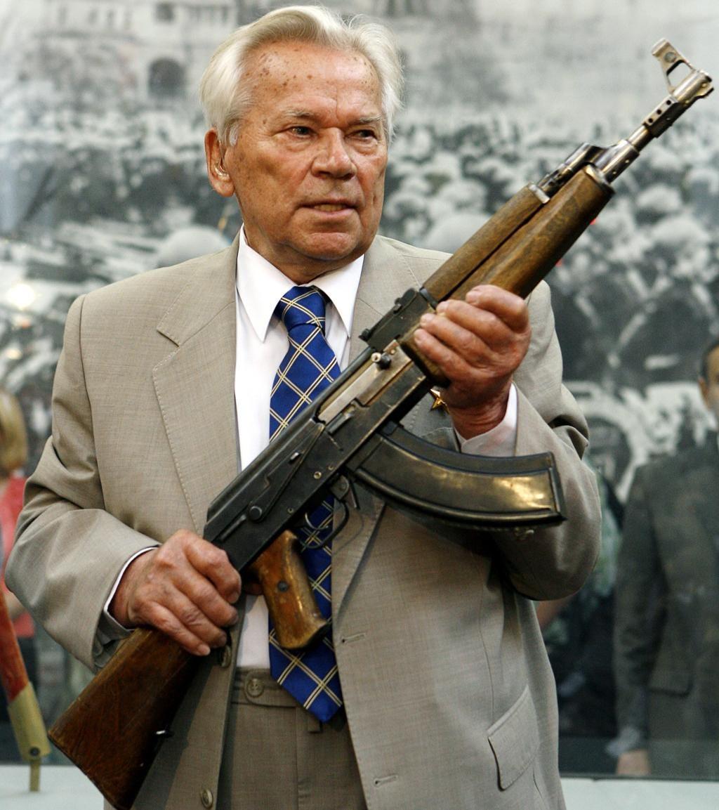 Mikhail Kalashnikov, now 91, holds the original AK-47 assault rifle