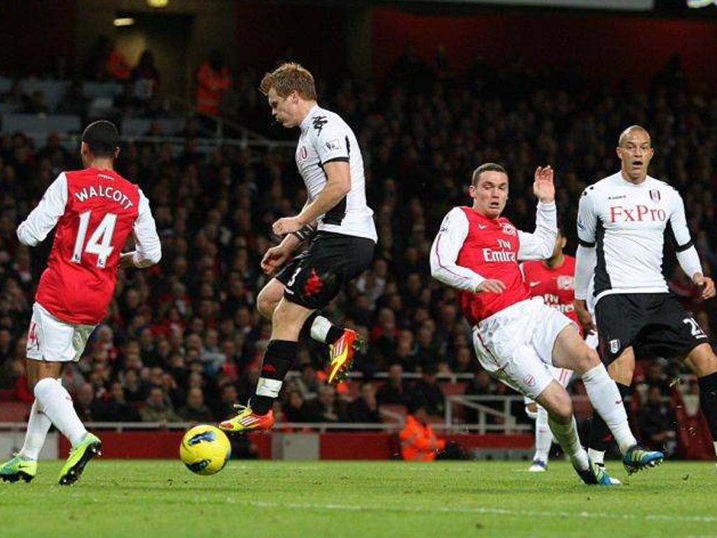 Arsenal's Thomas Vermaelen (second right) puts the ball into his own goal during an unconvincing display by the Gunners last night