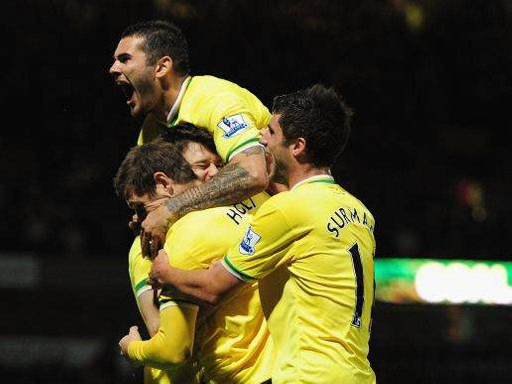 Norwich substitute Grant Holt celebrates his winner three minutes after entering the action against Queens Park Rangers at Carrow Road