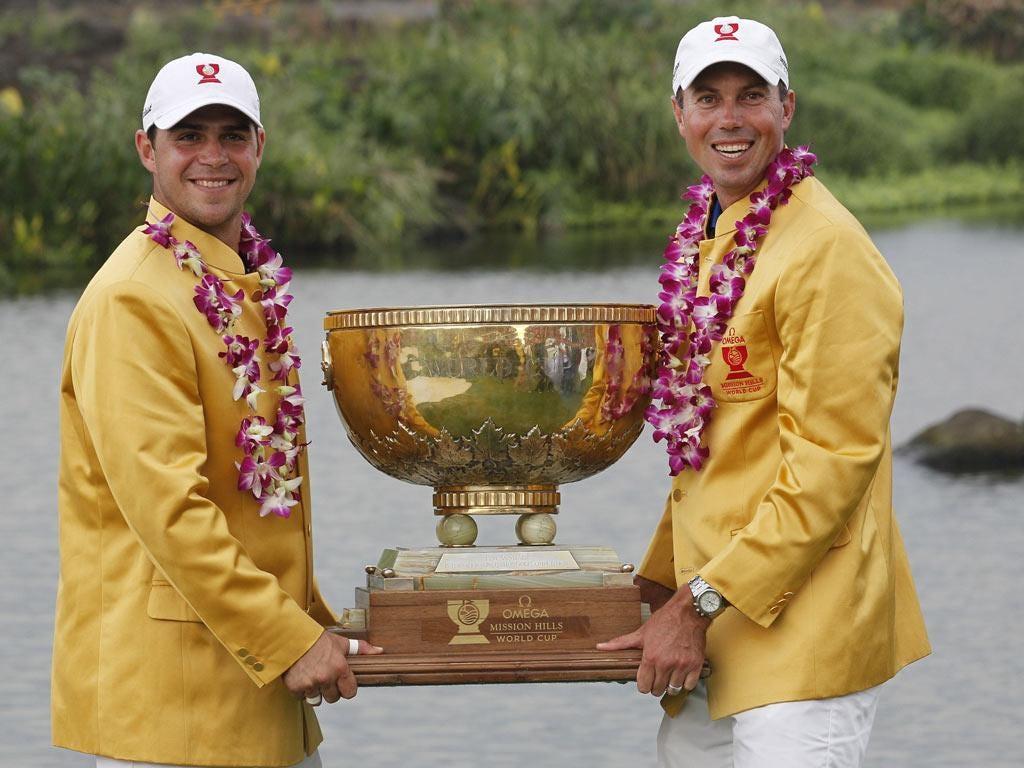 Matt Kuchar (right) and team-mate Gary Woodland celebrate