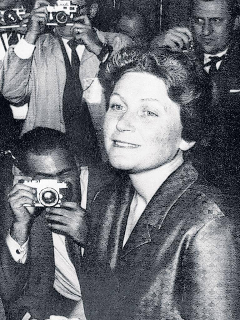 Peters talks to reporters in New York after her defection in 1967