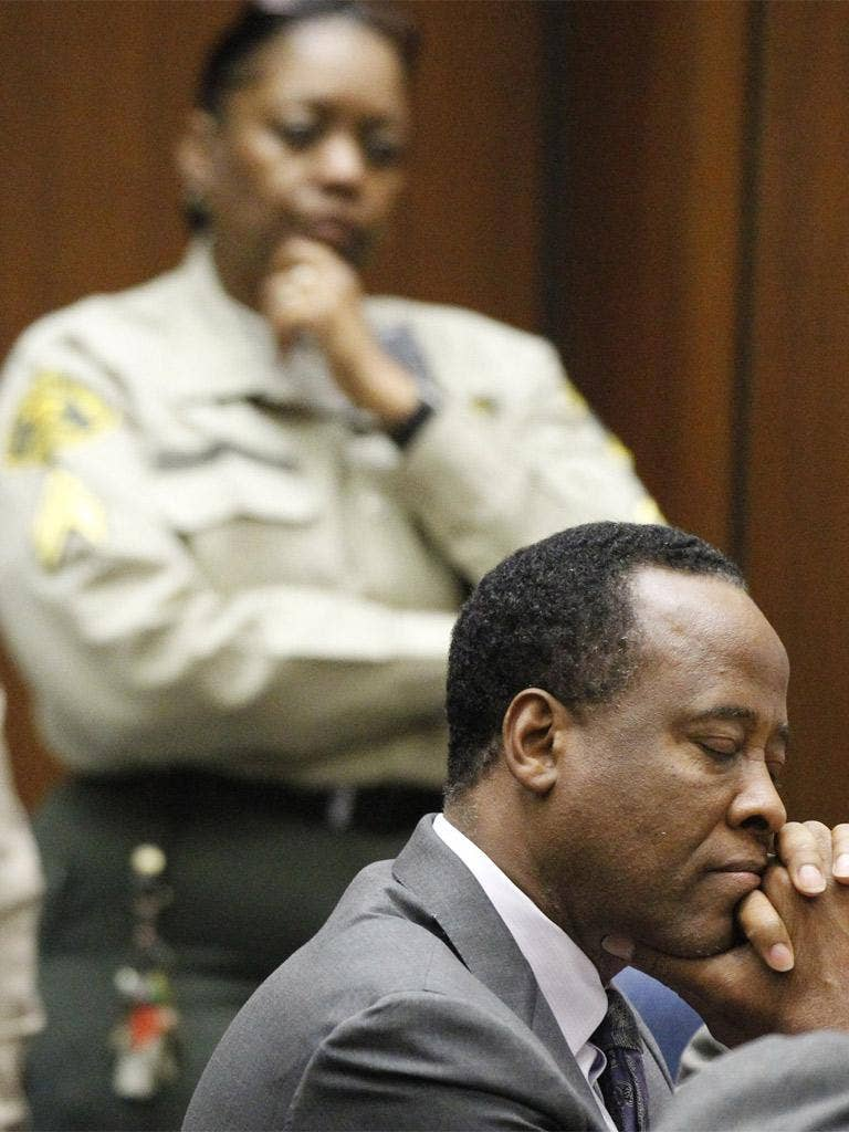 Conrad Murray listens as he is sentenced to four years in county jail; he is expected to serve only two years however