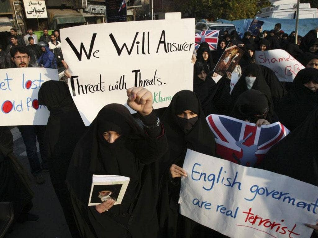 Female Iranian protesters attend an anti-British demonstration in front of the British Embassy, in Tehran, Iran