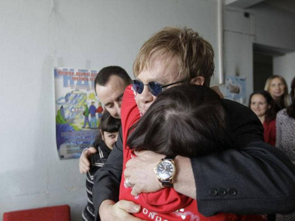 Scenes from Kiev: Elton John hugs a patient at a drop-in centre funded by his Aids Foundation