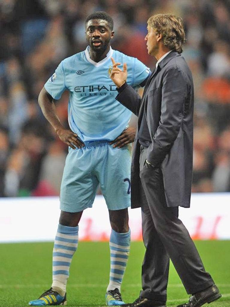 Kolo Touré thinks City can go the whole season unbeaten only if they 'forget about' the feat
