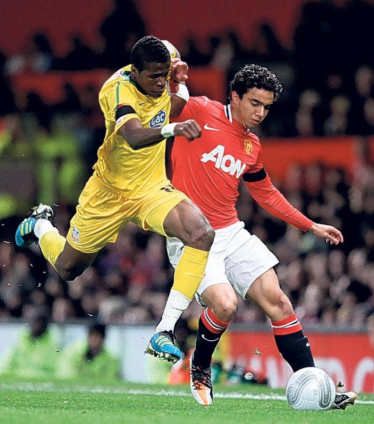 Crystal Palace's Wilfried Zaha (left) takes on Fabio da Silva