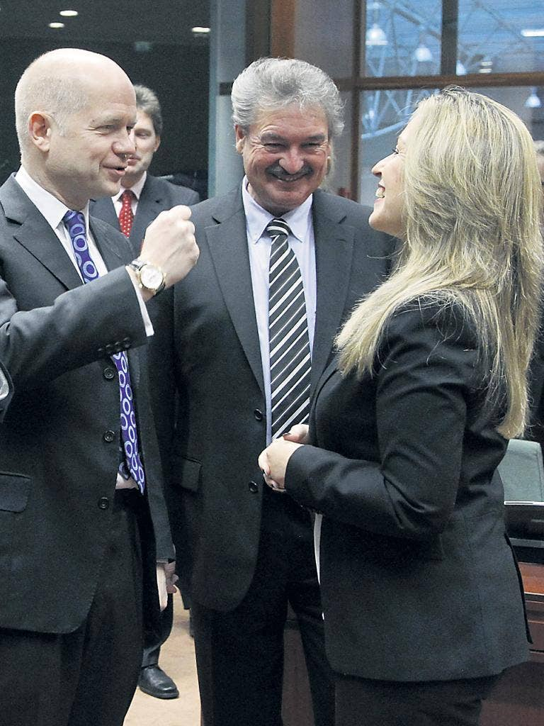 Left to right: Britain's William Hague, Jean Asselborn of Luxembourg and Spain's Trinidad Jiménez at the EU foreign ministers meeting