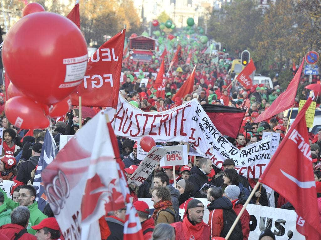 Protestors march during the demonstration in the streets of Brussels
