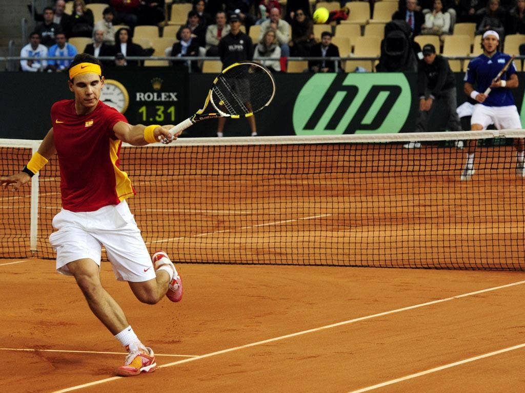 Spain's Rafael Nadal returns a ball to Argentina's Juan Monaco during the Davis Cup final