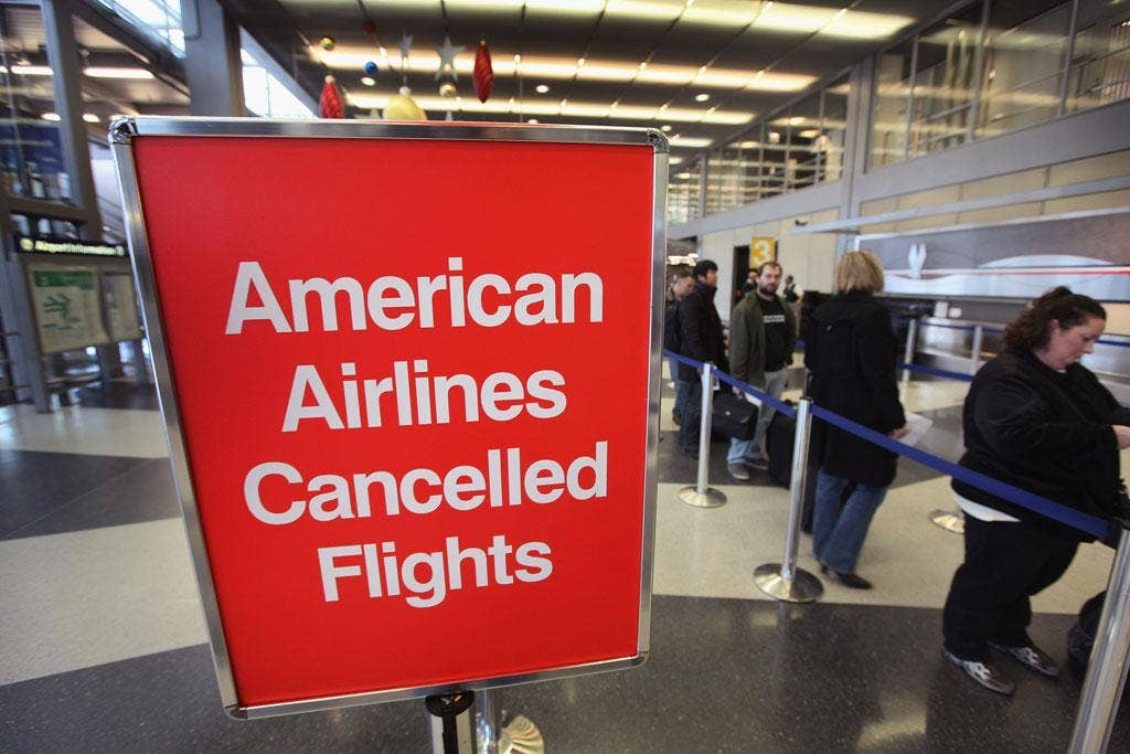 Grounded: American Airlines passengers try to re-book flights