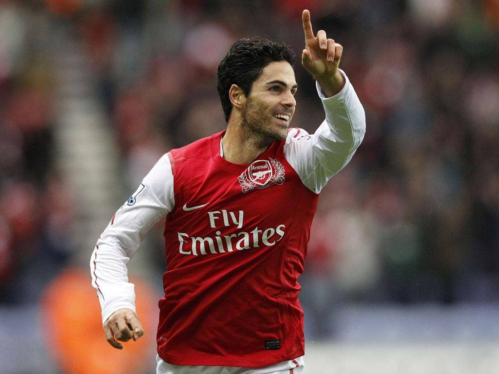 Arsenal's Mikel Arteta celebrates the opening goal yesterday after his tame 25-yard shot slips through the hands of Ali Al Habsi into the net