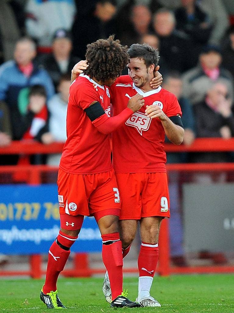 Matt Tubbs, right, scored a hat-trick in the League Two pacemakers' 5-0 romp