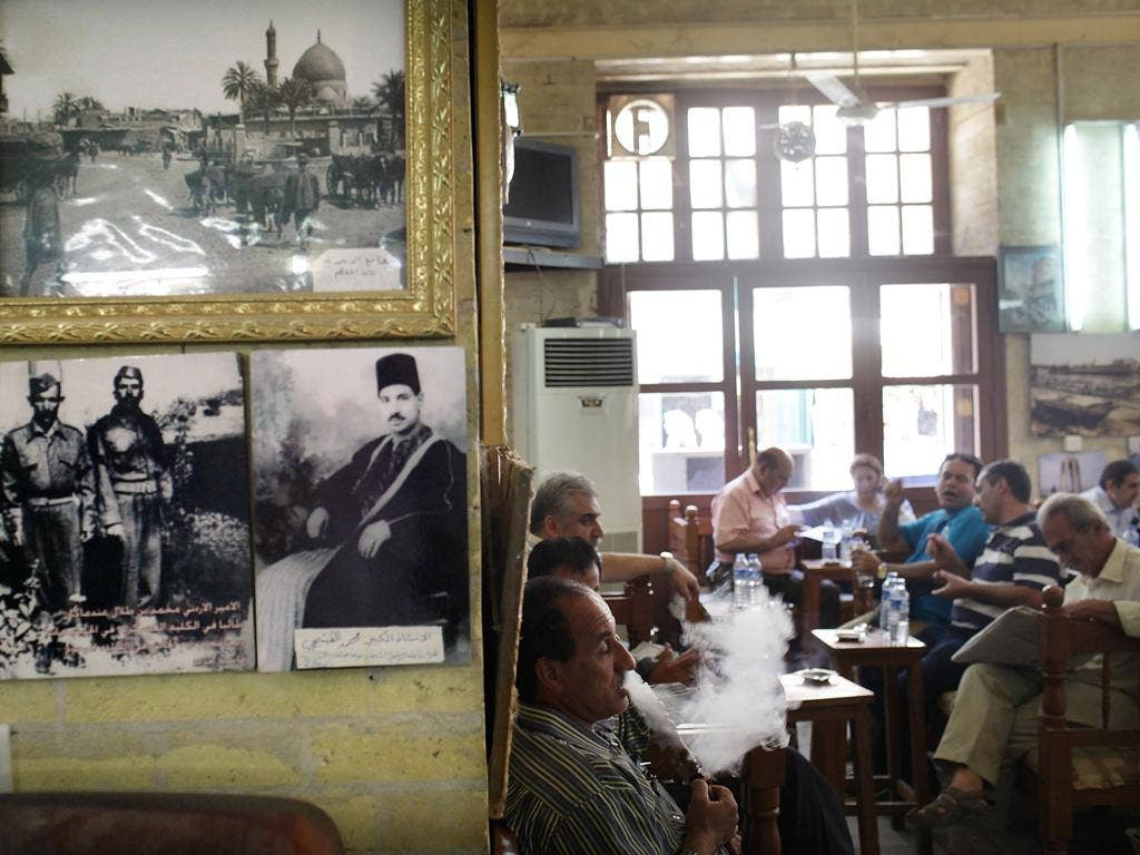 Even though life looks normal at Baghdad's Al-Shah Bender Café, car bombs are still a regular occurrence