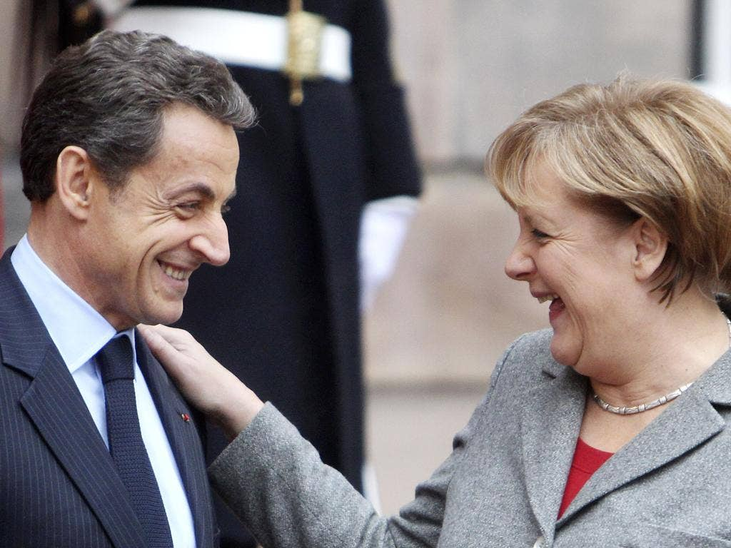 France's Nicolas Sarkozy and Germany's Angela Merkel are trying to stand united