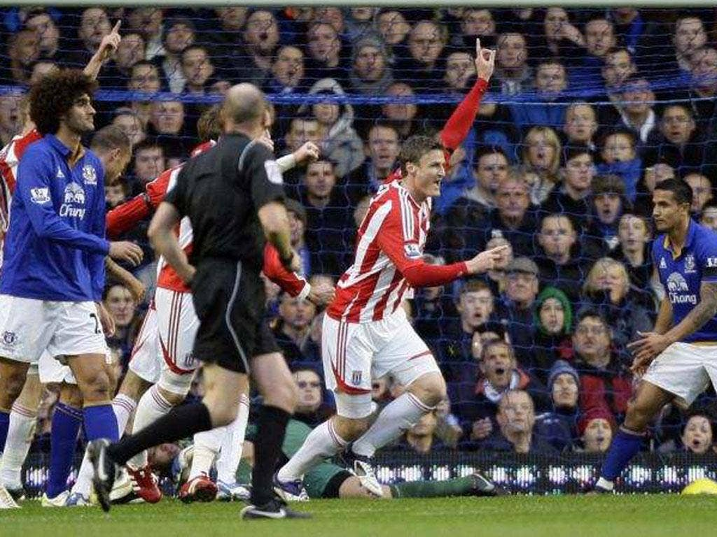 Stoke's Robert Huth celebrates scoring the only goal at Goodison