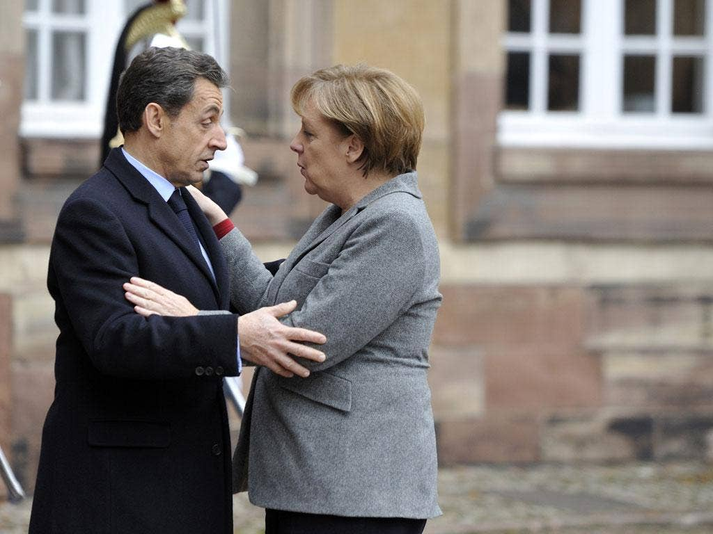 Sarkozy and Merkel at a european mini-summit with Italian Prime minister Mario Monti on the debt crisis, in November