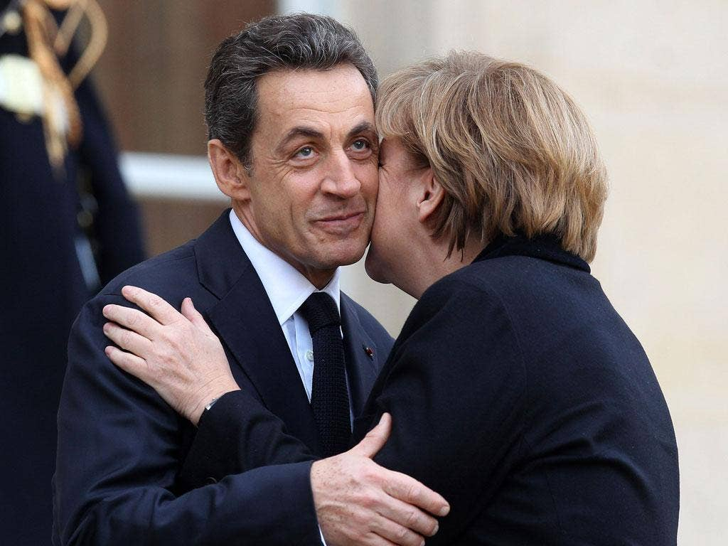 President Sarkozy and Chancellor Merkel met in Paris yesterday to agree plans to solve the EU debt crisis ahead of Thursday's summit