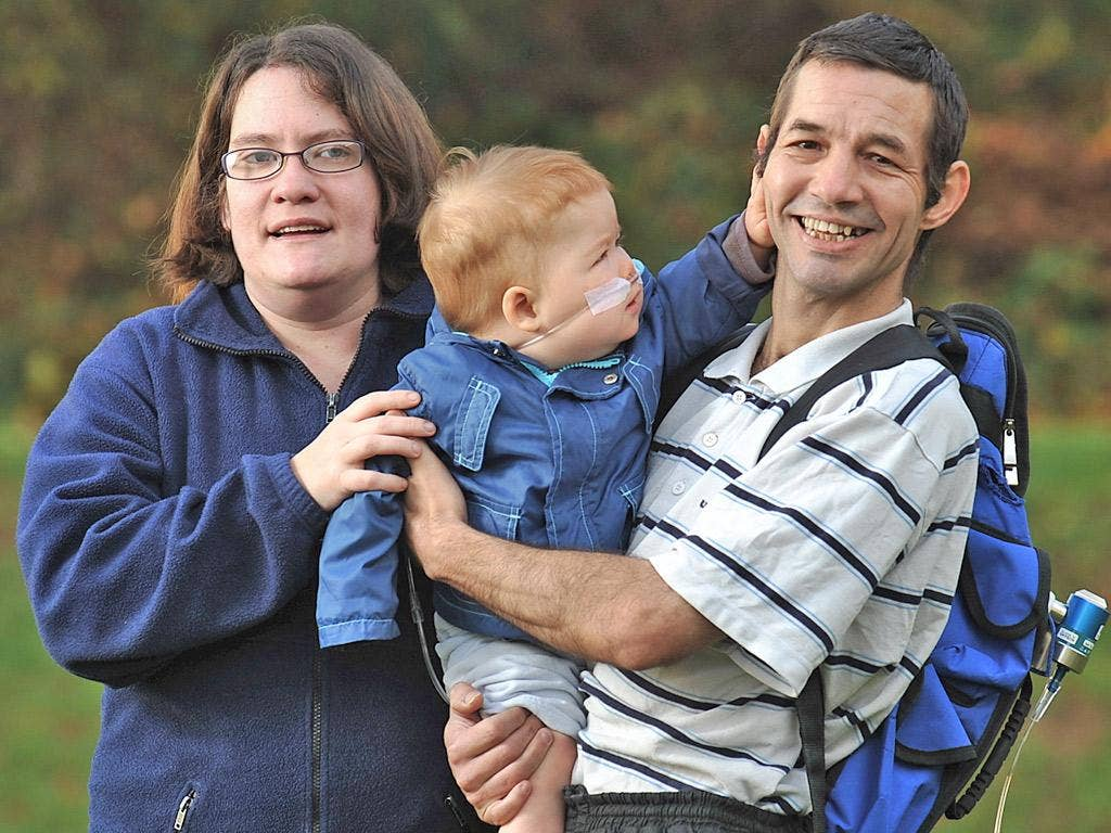 Emma West and Mark Rowe with Lewis, who has the same condition that killed his sister