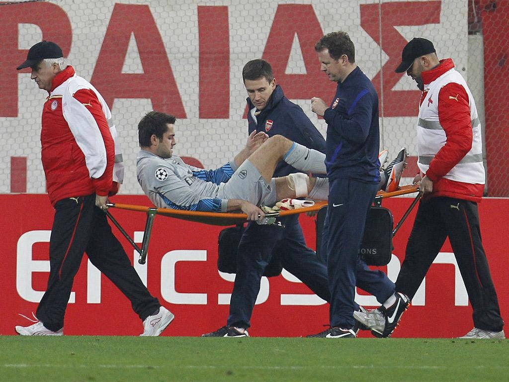 Arsenal's goalkeeper Lukasz Fabianski is carried from the pitch last night