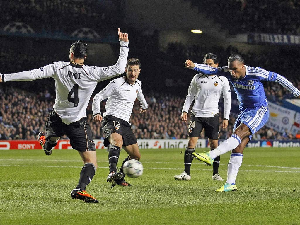 Didier Drogba fires home the first of his two goals last night