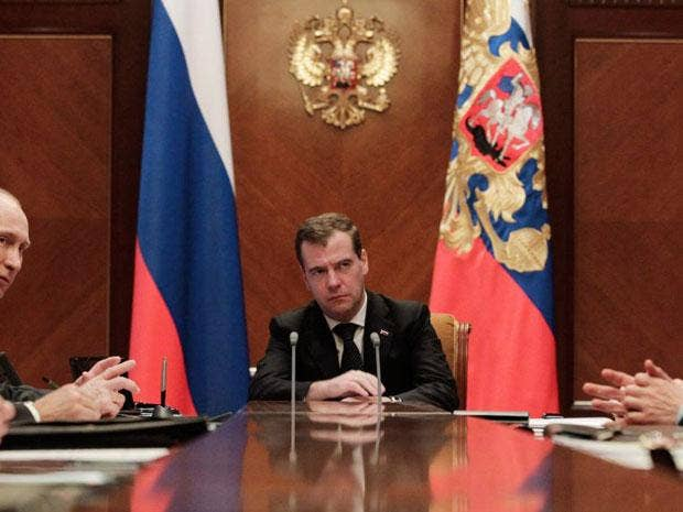 Russian President Dmitry Medvedev, centre, and Prime Minister Vladimir Putin, second left, attend a Security Council meeting today