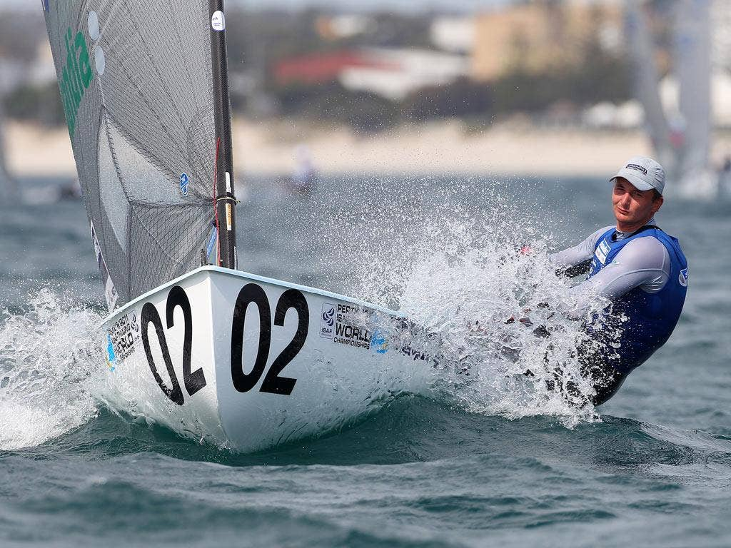 Wearing number two and lying second Giles Scott is determined to challenge Olympic champion  Ben Ainslie for the Finn title at the world championships of sailing off Fremantle, W Australia