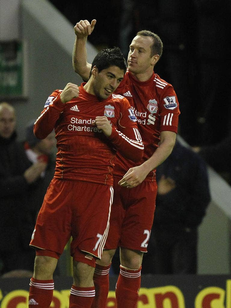 Charlie Adam gives the credit to Luis Suarez (left) after his goal for Liverpool, who recorded their first home win since 24 September