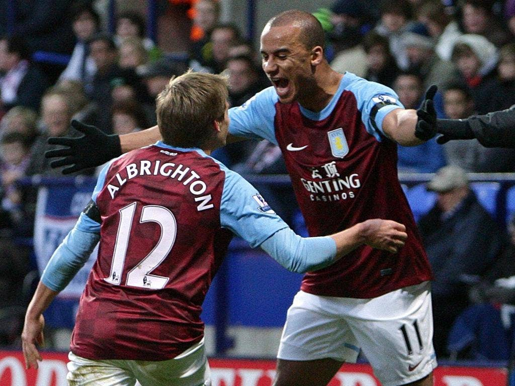 Gabby Agbonlahor (right) rushes to embrace Aston Villa's opening goalscorer, Marc Albrighton