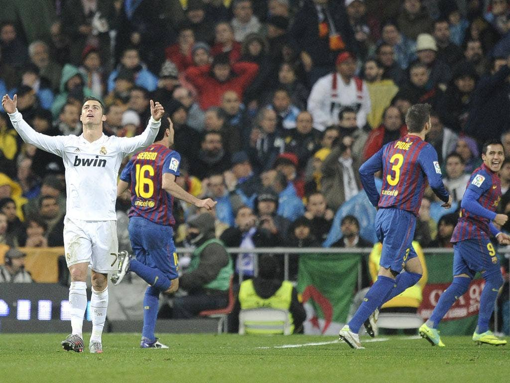 Contrasting emotions for Cristiano Ronaldo (left) and the Barcelona players